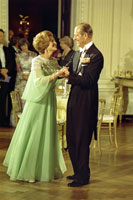 First Lady Betty Ford and Prince Philip dance during the state dinner in honor of Queen Elizabeth II and Prince Philip at the White House.  July 7, 1976.