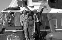 President Ford, vice presidential running mate Senator Robert Dole and Mrs. Elizabeth Dole debark Marine I to attend a campaign rally in the Senator's hometown. Russell, Kansas. August 20, 1976.