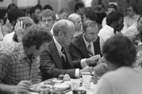 President Ford, University of Michigan football coach Bo Schembechler and members of the Michigan football team at the team's training table during a visit to the campus to Kick-Off the President's 1976 Presidential Campaign.  September 15, 1976.