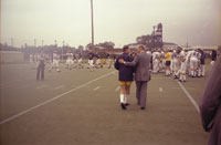 President Ford greets coach Bo Schembechler before heading for the practice field  in Ann Arbor.  September 15, 1976.