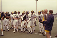 President Ford and coach Bo Schembechler watch the team practice. September 15, 1976.