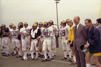 President Ford and coach Bo Schembechler watch the University of Michigan football team practice.