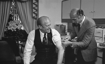 President Ford receives a swine flu inoculation from his White House physician, Dr. William Lukash, October 14, 1976