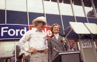 First Lady Betty Ford introduces her son Steve to a crowd gathered outside a President Ford Committee phone bank in Downey, California.  October 19, 1976.