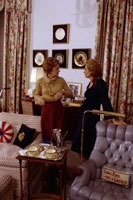 As part of a televised farewell interview with President and Mrs. Ford,  Mrs. Ford takes ABC correspondent Barbara Walters on a White House tour,  showing for the first time on television some of the occupied rooms on the third floor, such as the President's private office shown here.   December 4, 1976.
