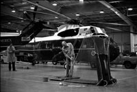 President Ford keeps in golf shape during a practice session in the Marine One Hangar at Andrews Air Force Base.  January 13, 1977.