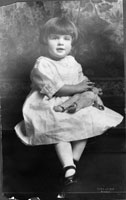 "Elizabeth Ann ""Betty"" Bloomer, age 3, with her teddy bear. April 1921."