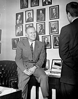 Representative Gerald R. Ford, Jr., talks to an unidentified visitor in his House Office