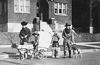 Gerald R. Ford, Jr., Carl Engel, Tom Ford, and an unidentified boy pose with their pioneer wagon after winning first prize in the Boys Day Parade. 1923.