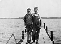 Gerald R. Ford, Jr. and his cousin Gardner James display the day's catch from a dock, Delavan Lake, WI.  1923