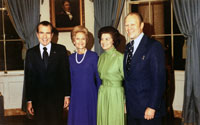 President and Mrs. Richard Nixon with Gerald and Betty Ford in the Blue Room of the White House following Representative Ford's nomination to succeed Spiro T. Agnew as Vice President. October 13, 1973.