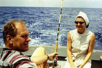 Gerald R. Ford and Betty Ford talk while Mr. Ford tries some deep-sea fishing during a vacation trip to Free Town, Eleutheria, Bahamas, with other Republican Congressmen and their wives. April 1966.