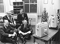 Representative Gerald R. Ford, Senator Everett M. Dirksen, Ray Bliss and Thruston Morton watch election returns on several televisions in an unidentified office. November 8, 1966.