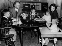 Gerald and Betty Ford and their children Mike, Jack, Susan, and Steve sit in the dining room of their home at 514 Crown View Drive, Alexandria, Virginia. 1958.