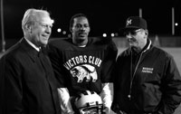 President Ford with University of Michigan football coach Bo Schembechler and All-American receiver Anthony Carter during a visit to Ann Arbor. November 10, 1982.