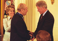President Clinton awards former President Ford the nation's highest civilian honor, the Presidential Medal of Freedom, in a White House ceremony on August 11, 1999.