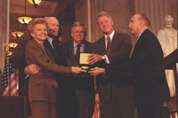 Gerald and Betty Ford receive the Congressional Gold Medal from Speaker of the House Dennis Hastert and Senator Strom Thurmond. Also shown in President Bill Clinton. October 27, 1999.