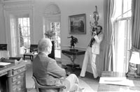 Photographer DAvid Kennerly takes an oval office photo of President Gerald R. Ford
