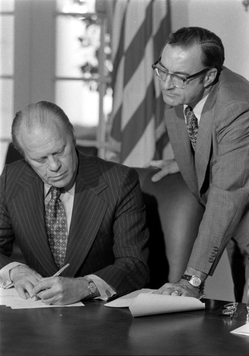 Bill Roberts assisting President Ford with preparations for his taped message to the Radio and Television News Directors conference, September 12, 1974 (A0739-14)