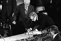 Rockefeller signing Senate book to be able to address the joint assembly.