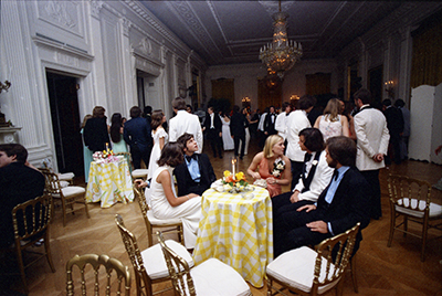 Susan Ford sitting with classmates and their dates during the Holton-Arms Senior Prom, 5/31/1975
