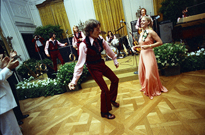 Susan Ford dancing with Sandcastle band member Billy Etheridge at the Holton-Arms School Senior Prom, 5/31/1975