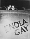 """Col. Paul W. Tibbets, Jr., pilot of the ENOLA GAY, the plane that dropped the atomic bomb on Hiroshima, waves from his cockpit before the takeoff, 6 August 1945."", 08/06/1945"