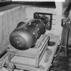 LB (Little Boy) unit on trailer cradle in pit. [Note bomb bay door in upper right-hand corner.], 08/1945