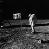 Photograph of Astronaut Edwin E. (Buzz) Aldrin, Jr. Posing on the Moon Next to the U.S. Flag , 07/20/1969