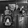"Photograph of President Truman and Prime Minister Churchill standing on the rear platform of a special Baltimore & Ohio train (evidently en route to Fulton, Missouri for Churchill's ""Iron Curtain"" Speech), with the President's Military Aide, General Harry Vaughan, seated nearby., 03/04/1946?"