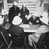 """Air raid wardens at a sector meeting in Washington, DC, discuss the zones they control during a practice air raid."", ca. 1941 - ca. 1945"
