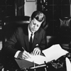 Photograph of President John F. Kennedy Signing the Proclamation for the Interdiction of the Delivery of Offensive Weapons to Cuba, 10/23/1962